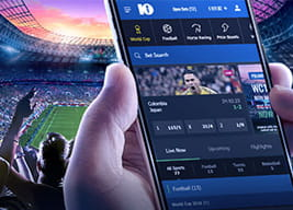10Bet mobile app in the hand of a punter at a football stadium
