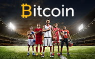 The Bitcoin logo over five footballers standing on a pitch