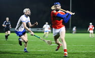 Two hurling players in a game