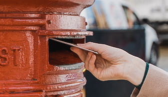 Posting the cheque into a postbox
