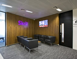 An office with the Skrill logo in it
