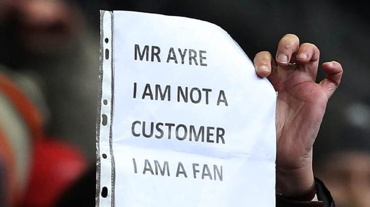 Fans argue they are supporters not customers