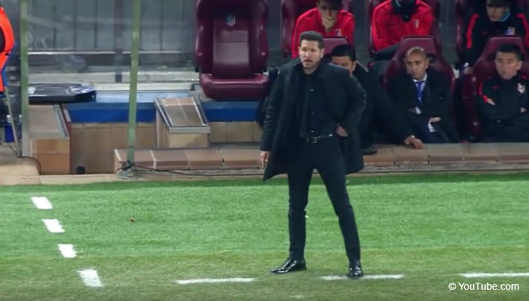 Diego Simeone stands on the touchline during Atletico's Champions League semi-final against Bayern.