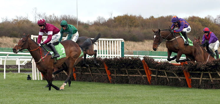Four horses jumping at the Fighting Fifth Hurdle