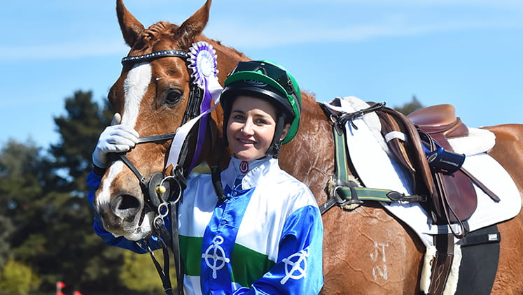 A jockey stands with her horse at the Melbourne Cup.
