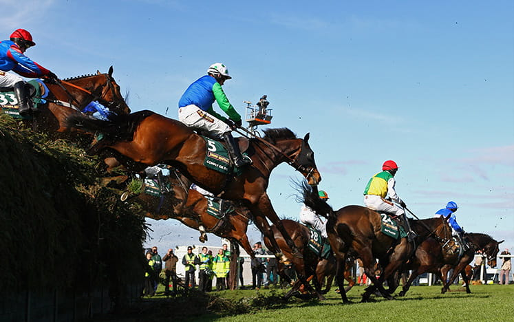 Five horses running at Becher Chase