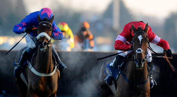 Two horses racing at the King George Chase