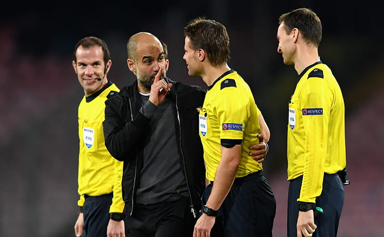 Guardiola speaking to the officials