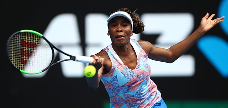 Venus Williams reaching for a ball