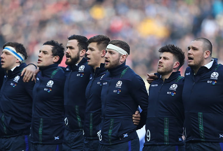 Scotland rugby team lining up to sing the national anthem