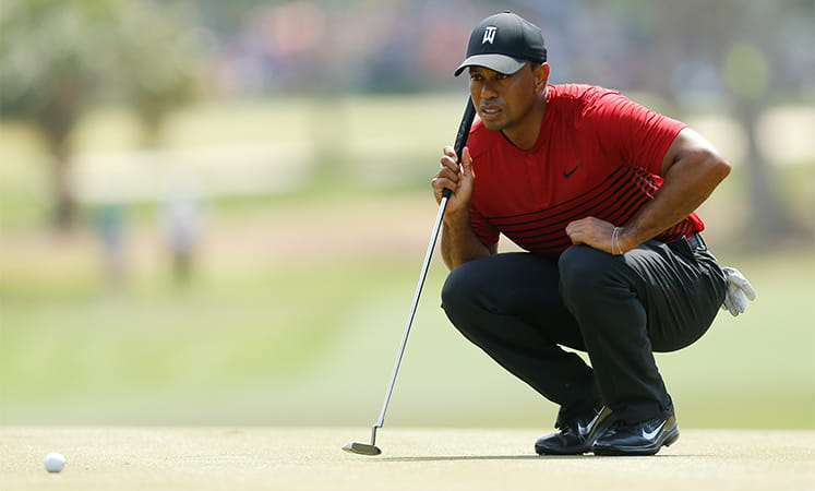 Tiger Woods lining up a putt