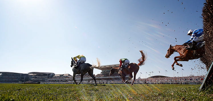 Two horses racing at the Grand National