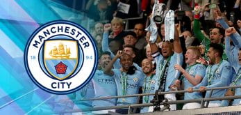 Manchester City players celebrating winning the 17/18 Premier League
