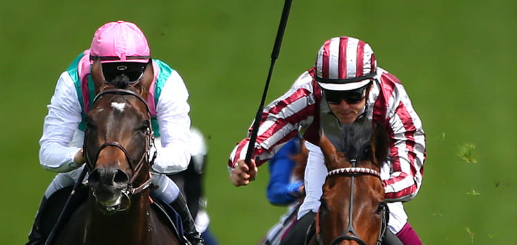 Two horses riding at Epsom