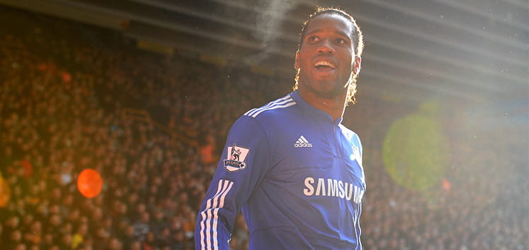 Didier Drogba standing looking towards the crowd
