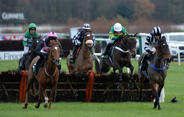 Horses jumping a fence at the Fighting Fifth Hurdle