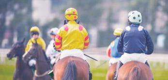 Rear shot of three riders at Doncaster